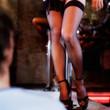 An erotic dancer teasing a client