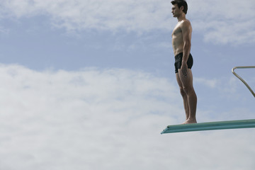 A diver standing on a diving board