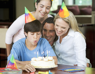 A family celebrating their son's birthday
