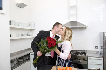 Businessman presenting his partner with flowers