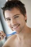 Young man brushing his teeth, close-up