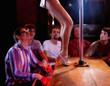 Men watching a pole dancer
