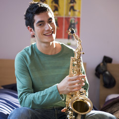 A teenage boy with a saxophone