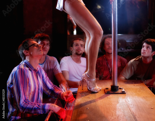 Men watching a pole dancer