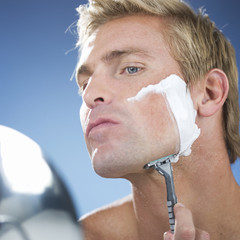 A young man shaving