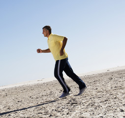 A man jogging on a beach