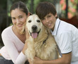 Portrait of a brother and sister with their dog