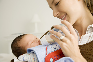 A mother bottle feeding her baby