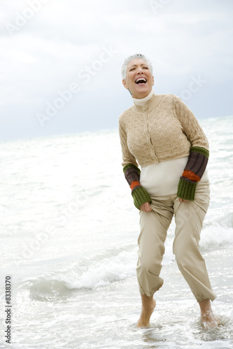 A senior woman on a beach