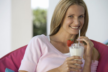 A woman drinking a health drink