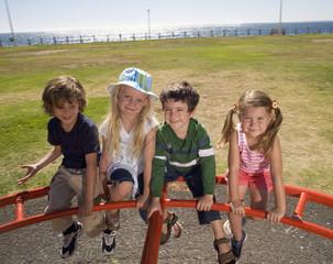 Four children on a playground