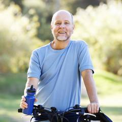 A senior man cycling
