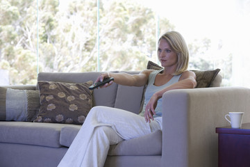 A woman using a remote control