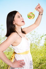 Woman and lollipop