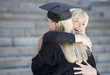 A graduate hugging her mother