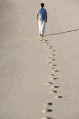 A man walking on a beach