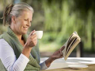 A senior woman reading a book