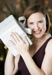 A woman holding a present
