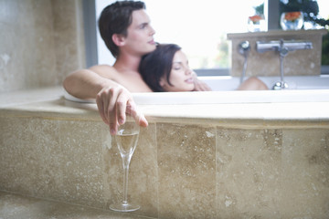A couple laying in a bath