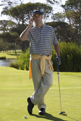 Man talking on a mobile phone on the golf course