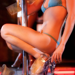 Close-up of a pole dancer collecting tips