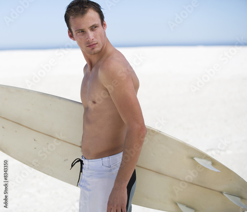 Young man with a surf board