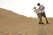 A young couple dancing in the desert