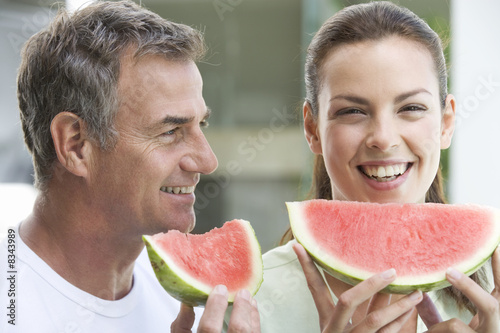 A couple eating watermelon