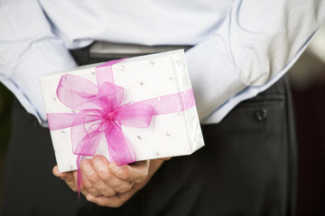 A man holding a surprise gift