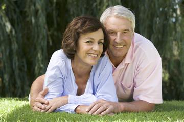 A senior couple in a garden