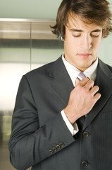 A businessman checking his tie