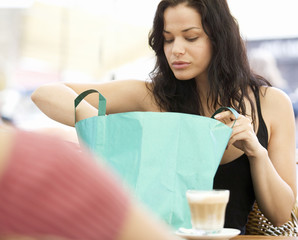 A young woman looking at her purchases