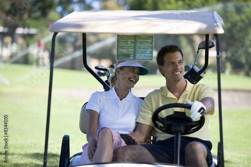 Couple in a golf buggy