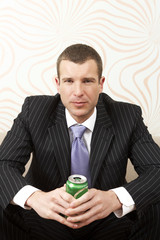 Businessman holding a canned drink