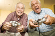 Two elderly men playing a video game