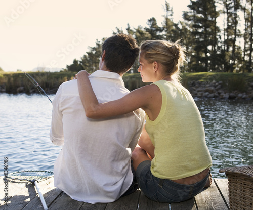 A young couple fishing