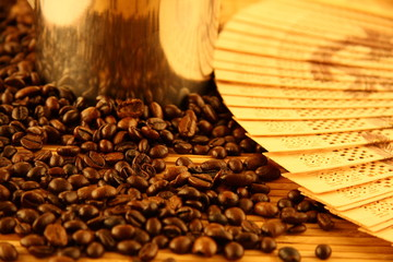 Coffee beans with wooden fan
