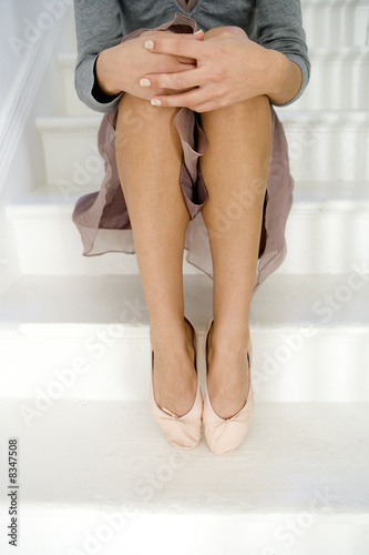 A young woman sitting on stairs