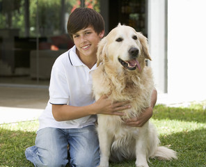 Portrait of a young boy with his pet dog
