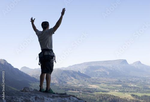 A climber celebrating reaching the top