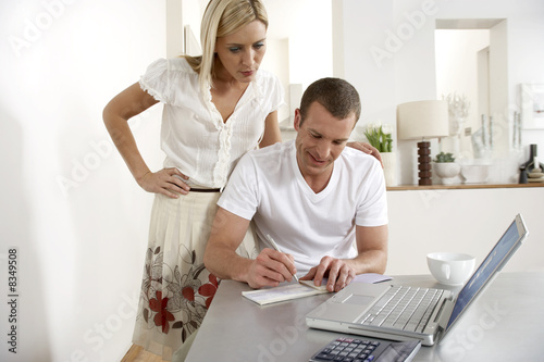 Young couple working from home