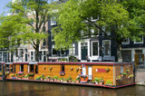 amsterdam holland canal house boat with flowers