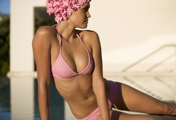 A woman in a bikini and swimming hat