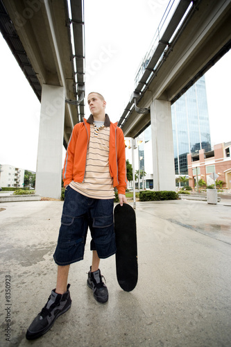 A teenager with a skateboard