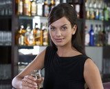 A woman drinking champagne in a bar