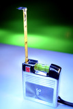 Tape measure with built-in spirit level poster