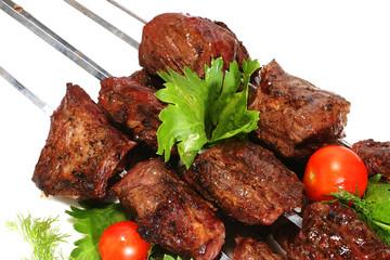 shish kebab on skewer over white