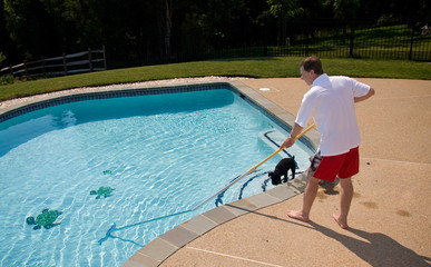Man brushing pool