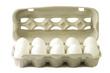 Leinwandbild Motiv Weisse Eier im Pappkarton
