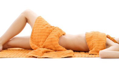 torso of relaxed lady with orange towels